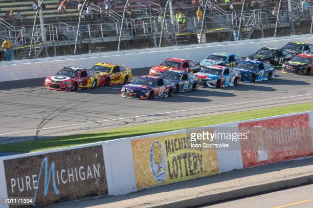 Kyle Larson driver of the Cars 3/Target Chevrolet Denny Hamlin driver of the FedEx Office Toyota Joey Logano driver of the Shell Pennzoil Ford and...