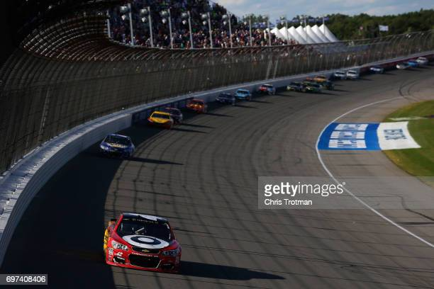 Kyle Larson driver of the Cars 3/Target Chevrolet leads Chase Elliott driver of the NAPA Chevrolet and the field to win the Monster Energy NASCAR Cup...
