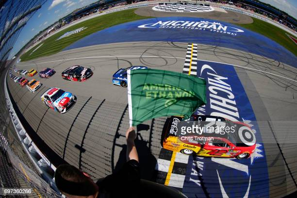 Kyle Larson driver of the Cars 3/Target Chevrolet leads the field to the green flag during the Monster Energy NASCAR Cup Series FireKeepers Casino...