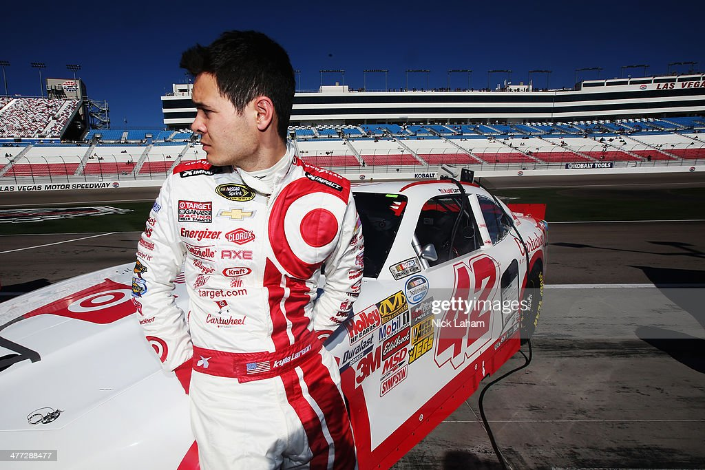 <a gi-track='captionPersonalityLinkClicked' href=/galleries/search?phrase=Kyle+Larson&family=editorial&specificpeople=2115989 ng-click='$event.stopPropagation()'>Kyle Larson</a>, driver of the #42 Cartwheel Chevrolet, stands on the grid during qualifying for the NASCAR Nationwide Series Boyd Gaming 300 at Las Vegas Motor Speedway on March 8, 2014 in Las Vegas, Nevada.