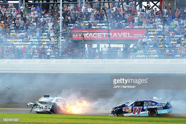 Kyle Larson driver of the Clorox Chevrolet and Elliott Sadler driver of the OneMain Toyota are involved in an incident at the finish of the NASCAR...