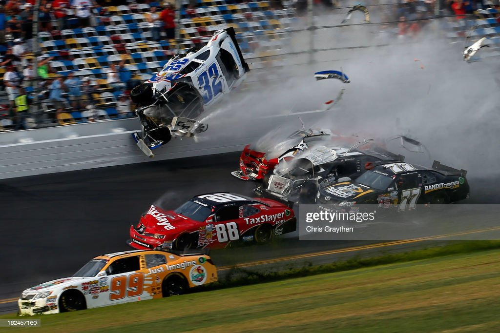 <a gi-track='captionPersonalityLinkClicked' href=/galleries/search?phrase=Kyle+Larson&family=editorial&specificpeople=2115989 ng-click='$event.stopPropagation()'>Kyle Larson</a>, driver of the #32 Clorox Chevrolet, <a gi-track='captionPersonalityLinkClicked' href=/galleries/search?phrase=Justin+Allgaier&family=editorial&specificpeople=5380573 ng-click='$event.stopPropagation()'>Justin Allgaier</a>, driver of the #31 Brandt Chevrolet, Brian Scott, driver of the #2 Shore Lodge Chevrolet, and <a gi-track='captionPersonalityLinkClicked' href=/galleries/search?phrase=Parker+Kligerman&family=editorial&specificpeople=6348144 ng-click='$event.stopPropagation()'>Parker Kligerman</a>, driver of the #77 Bandit Chippers Toyota, are involved in an incident at the finish of the NASCAR Nationwide Series DRIVE4COPD 300 at Daytona International Speedway on February 23, 2013 in Daytona Beach, Florida.