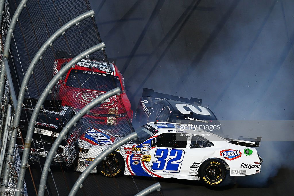 <a gi-track='captionPersonalityLinkClicked' href=/galleries/search?phrase=Kyle+Larson&family=editorial&specificpeople=2115989 ng-click='$event.stopPropagation()'>Kyle Larson</a>, driver of the #32 Clorox Chevrolet, <a gi-track='captionPersonalityLinkClicked' href=/galleries/search?phrase=Justin+Allgaier&family=editorial&specificpeople=5380573 ng-click='$event.stopPropagation()'>Justin Allgaier</a>, driver of the #31 Brandt Chevrolet, Brian Scott, driver of the #2 Shore Lodge Chevrolet, and <a gi-track='captionPersonalityLinkClicked' href=/galleries/search?phrase=Brad+Keselowski&family=editorial&specificpeople=890258 ng-click='$event.stopPropagation()'>Brad Keselowski</a>, driver of the #22 Discount Tire Dodge, are involved in an incident at the finish of the NASCAR Nationwide Series DRIVE4COPD 300 at Daytona International Speedway on February 23, 2013 in Daytona Beach, Florida.
