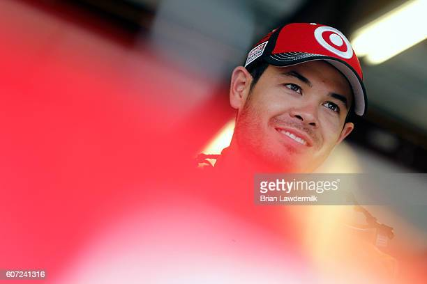 Kyle Larson driver of the Coke Chevrolet stands in the garage area during practice for the NASCAR Sprint Cup Series Teenage Mutant Ninja Turtles 400...