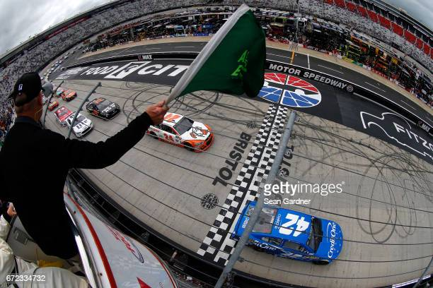 Kyle Larson driver of the Credit One Bank Chevrolet and Chase Elliott driver of the Mountain Dew/Little Caesars Chevrolet take the green flag to...