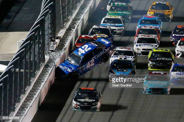 Kyle Larson driver of the Credit One Bank Chevrolet is involved in an ontrack incident with Ryan Blaney driver of the Motorcraft/Quick Lane Tire Auto...