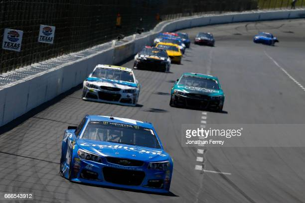 Kyle Larson driver of the Credit One Bank Chevrolet leads a pack of cars during the Monster Energy NASCAR Cup Series O'Reilly Auto Parts 500 at Texas...