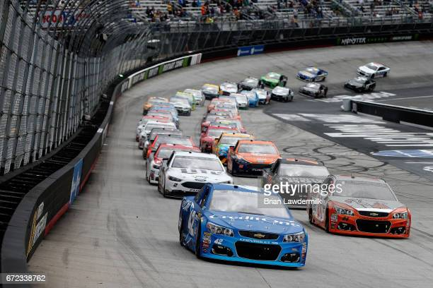 Kyle Larson driver of the Credit One Bank Chevrolet leads the field into turn one after the start of the Monster Energy NASCAR Cup Series Food City...