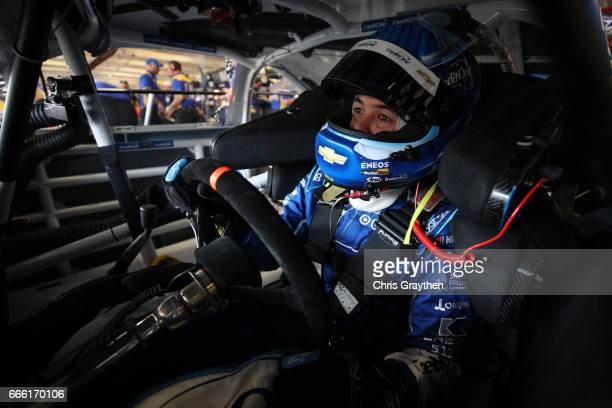 Kyle Larson driver of the Credit One Bank Chevrolet sits in his car during practice for the Monster Energy NASCAR Cup Series O'Reilly Auto Parts 500...