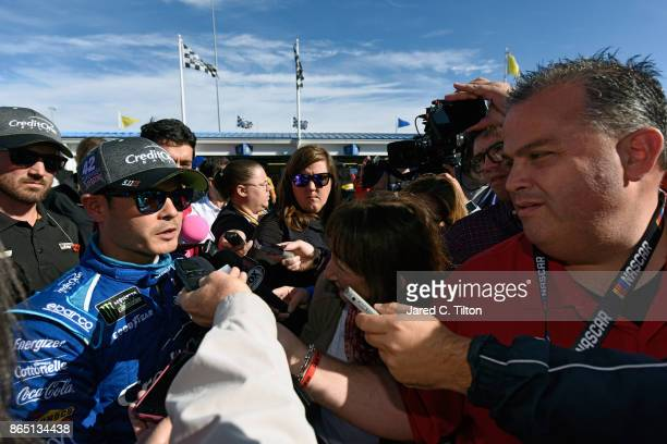 Kyle Larson driver of the Credit One Bank Chevrolet speaks with the media after having engine trouble during the Monster Energy NASCAR Cup Series...