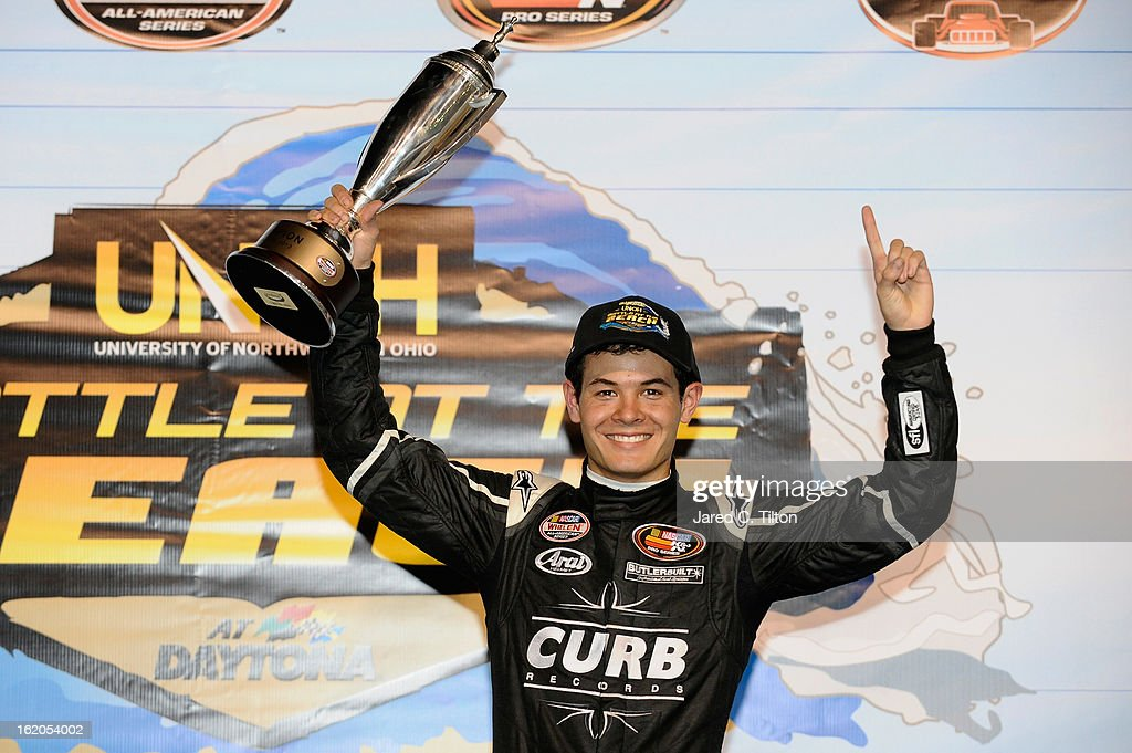 <a gi-track='captionPersonalityLinkClicked' href=/galleries/search?phrase=Kyle+Larson&family=editorial&specificpeople=2115989 ng-click='$event.stopPropagation()'>Kyle Larson</a>, driver of the #98 Curb Records NASCAR K&N Pro Series racecar, celebrates in Victory Lane after winning the UNOH Battle At The Beach at Daytona International Speedway on February 18, 2013 in Daytona Beach, Florida.