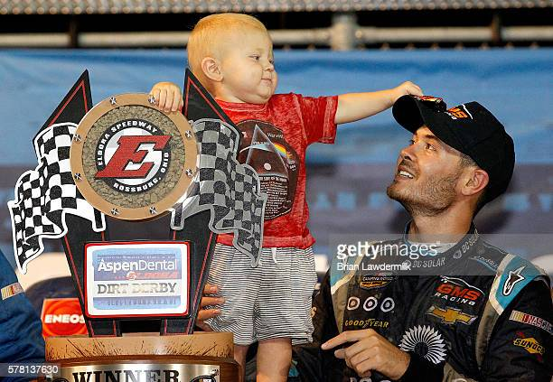 Kyle Larson driver of the DC Solar Chevrolet and his son Owen Larson hold the NASCAR Camping World Series 4th Annual Aspen Dental Eldora Dirt Derby...