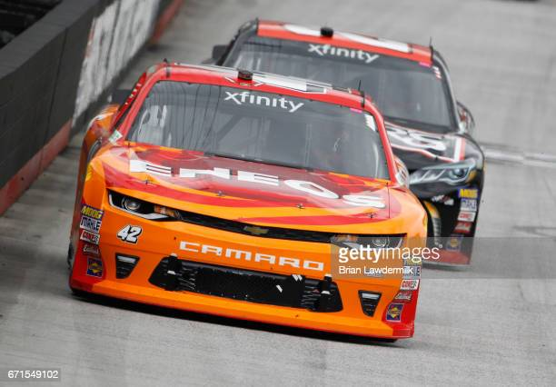 Kyle Larson driver of the ENEOS Chevrolet leads Erik Jones driver of the Reser's American Classic Toyota during the NASCAR XFINITY Series Fitzgerald...