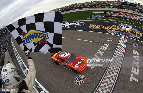 Kyle Larson driver of the ENEOS Chevrolet takes the checkered flag to win the NASCAR XFINITY Series O'Reilly Auto Parts Challenge at Texas Motor...