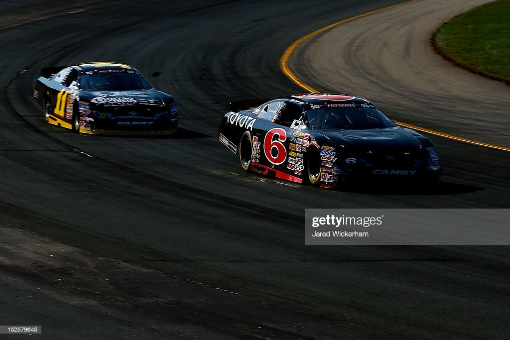 <a gi-track='captionPersonalityLinkClicked' href=/galleries/search?phrase=Kyle+Larson&family=editorial&specificpeople=2115989 ng-click='$event.stopPropagation()'>Kyle Larson</a>, driver of the #6 Rev Racing Toyota, leads Brett Moffitt drives the #11 Nitro Circus The Movie 3D Toyota during the NASCAR K&N Pro Series East G-Oil 100 at New Hampshire Motor Speedway on September 22, 2012 in Loudon, New Hampshire.