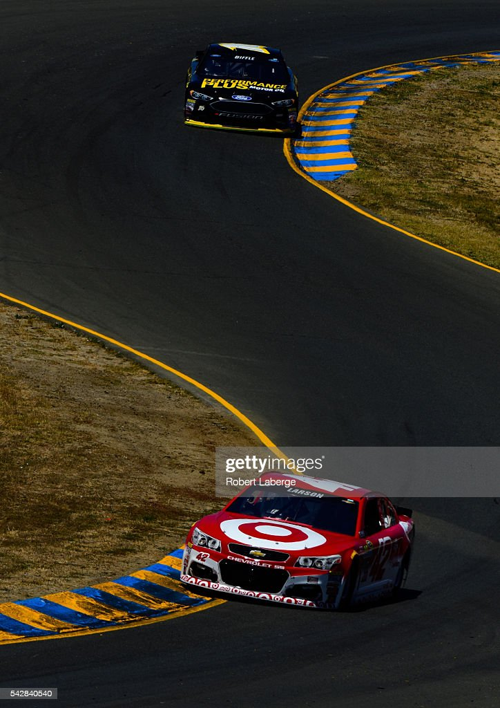 <a gi-track='captionPersonalityLinkClicked' href=/galleries/search?phrase=Kyle+Larson+-+Race+Car+Driver&family=editorial&specificpeople=2115989 ng-click='$event.stopPropagation()'>Kyle Larson</a>, driver of the #42 Target Chevrolet, and <a gi-track='captionPersonalityLinkClicked' href=/galleries/search?phrase=Greg+Biffle&family=editorial&specificpeople=209093 ng-click='$event.stopPropagation()'>Greg Biffle</a>, driver of the #16 Performance Plus Motor Oil Ford, drive during practice for the NASCAR Sprint Cup Series Toyota/Save Mart 350 at Sonoma Raceway on June 24, 2016 in Sonoma, California.