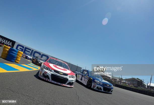 Kyle Larson driver of the Target Chevrolet and Jamie McMurray driver of the Cessna Chevrolet lead the field during pace lap prior to the start of the...