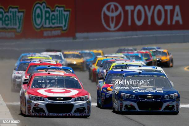 Kyle Larson driver of the Target Chevrolet and Jamie McMurray driver of the Cessna Chevrolet lead the field to start the Monster Energy NASCAR Cup...