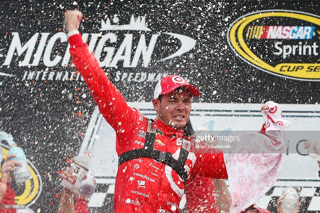 Kyle Larson, driver of the #42 Target Chevrolet, celebrates in victory lane after winning the NASCAR Sprint Cup Series Pure Michigan 400 at Michigan International Speedway on August 28, 2016 in Brooklyn, Michigan.