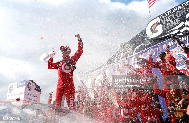Kyle Larson driver of the Target Chevrolet celebrates in victory lane after winning the Monster Energy NASCAR Cup Series Auto Club 400 at Auto Club...