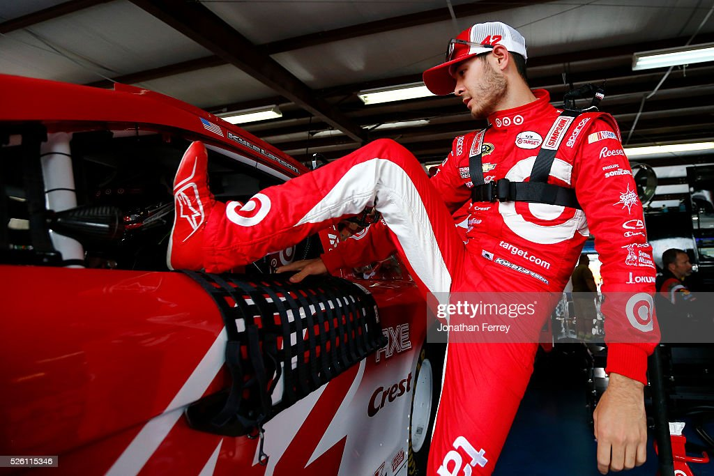 Kyle Larson, driver of the #42 Target Chevrolet, climbs into his car during practice for the NASCAR Sprint Cup Series GEICO 500 at Talladega Superspeedway on April 29, 2016 in Talladega, Alabama.