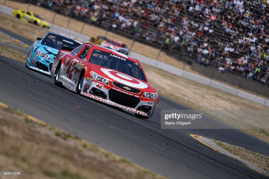 <a gi-track='captionPersonalityLinkClicked' href=/galleries/search?phrase=Kyle+Larson+-+Race+Car+Driver&family=editorial&specificpeople=2115989 ng-click='$event.stopPropagation()'>Kyle Larson</a>, driver of the #42 Target Chevrolet, leads a pack of cars during the NASCAR Sprint Cup Series Toyota/Save Mart 350 at Sonoma Raceway on June 26, 2016 in Sonoma, California.