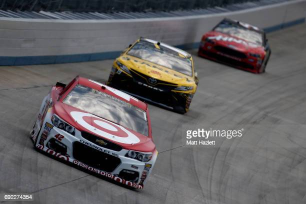 Kyle Larson driver of the Target Chevrolet leads a pack of cars during the Monster Energy NASCAR Cup Series AAA 400 Drive for Autism at Dover...