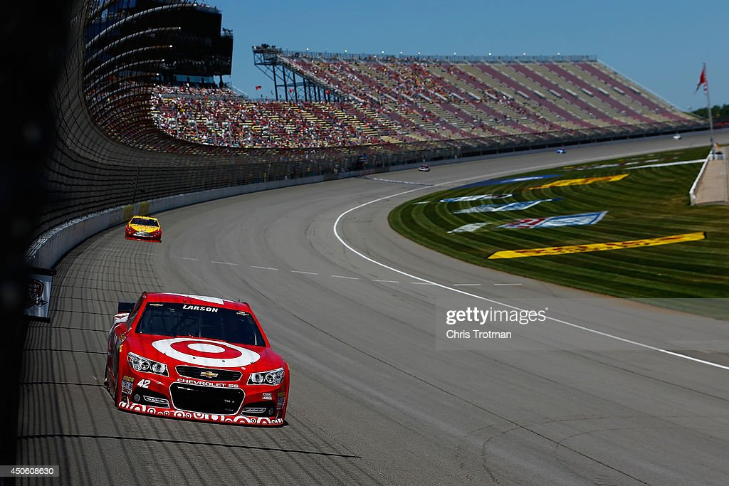 Kyle Larson, driver of the #42 Target Chevrolet, leads Joey Logano, driver of the #22 Shell Pennzoil Ford, during practice for the NASCAR Sprint Cup Series Quicken Loans 400 at Michigan International Speedway on June 14, 2014 in Brooklyn, Michigan.