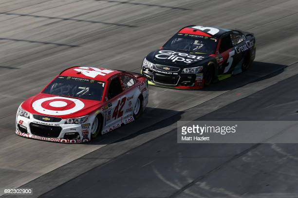 Kyle Larson driver of the Target Chevrolet leads Kasey Kahne driver of the Great Clips Chevrolet during the Monster Energy NASCAR Cup Series AAA 400...