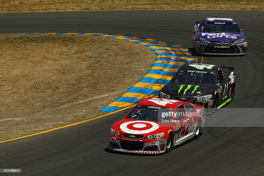 <a gi-track='captionPersonalityLinkClicked' href=/galleries/search?phrase=Kyle+Larson+-+Race+Car+Driver&family=editorial&specificpeople=2115989 ng-click='$event.stopPropagation()'>Kyle Larson</a>, driver of the #42 Target Chevrolet, leads <a gi-track='captionPersonalityLinkClicked' href=/galleries/search?phrase=Kurt+Busch&family=editorial&specificpeople=201728 ng-click='$event.stopPropagation()'>Kurt Busch</a>, driver of the #41 Monster Energy/Haas Automation Chevrolet, and <a gi-track='captionPersonalityLinkClicked' href=/galleries/search?phrase=Denny+Hamlin&family=editorial&specificpeople=504674 ng-click='$event.stopPropagation()'>Denny Hamlin</a>, driver of the #11 FedEx Cares Toyota, during the NASCAR Sprint Cup Series Toyota/Save Mart 350 at Sonoma Raceway on June 26, 2016 in Sonoma, California.