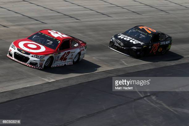 Kyle Larson driver of the Target Chevrolet leads Martin Truex Jr driver of the Furniture Row/Denver Mattress Toyota during the Monster Energy NASCAR...