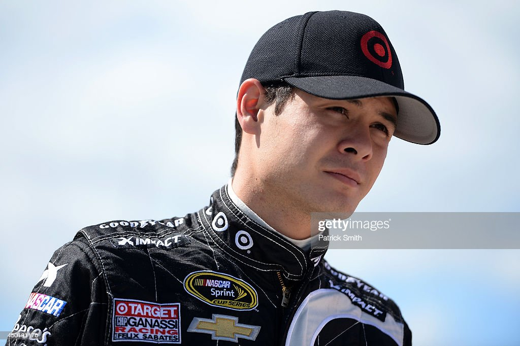 <a gi-track='captionPersonalityLinkClicked' href=/galleries/search?phrase=Kyle+Larson+-+Race+Car+Driver&family=editorial&specificpeople=2115989 ng-click='$event.stopPropagation()'>Kyle Larson</a>, driver of the #42 Target Chevrolet, looks on from the grid during qualifying for the NASCAR Sprint Cup Series Pocono 400 at Pocono Raceway on June 6, 2014 in Long Pond, Pennsylvania.