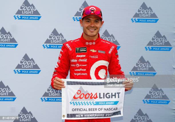 Kyle Larson driver of the Target Chevrolet poses with the Coors Light Pole Award after qualifying in the pole position for the Monster Energy NASCAR...