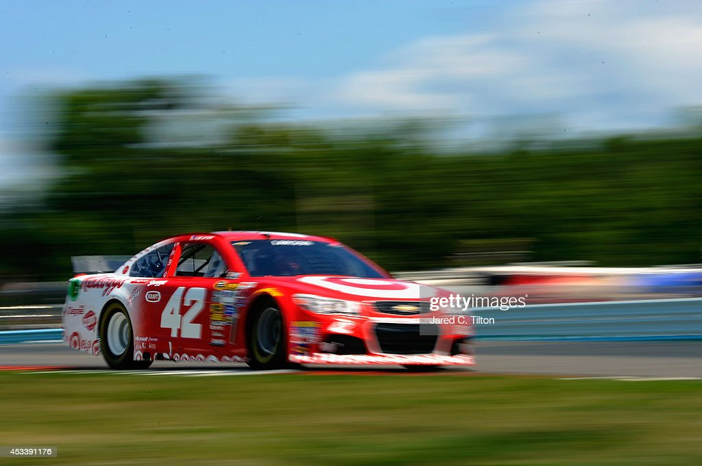<a gi-track='captionPersonalityLinkClicked' href=/galleries/search?phrase=Kyle+Larson+-+Race+Car+Driver&family=editorial&specificpeople=2115989 ng-click='$event.stopPropagation()'>Kyle Larson</a>, driver of the #42 Target Chevrolet, qualifies for the NASCAR Sprint Cup Series Cheez-It 355 at Watkins Glen International on August 9, 2014 in Watkins Glen, New York.