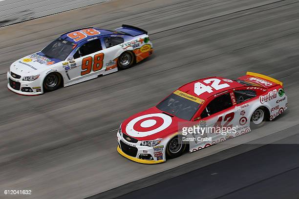 Kyle Larson driver of the Target Chevrolet races Timmy Hill driver of the Vydox Plus Chevrolet during the NASCAR Sprint Cup Series Citizen Solider...
