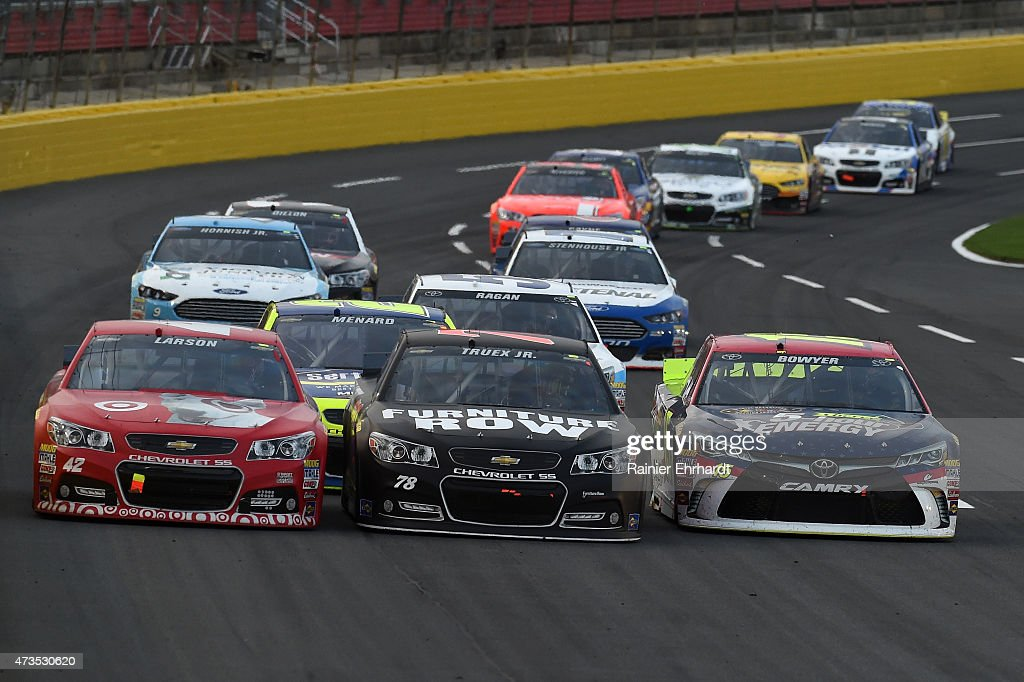 Kyle Larson driver of the Target Chevrolet races with Martin Truex Jr driver of the Furniture Row/Visser Precision Chevrolet and Clint Bowyer driver...