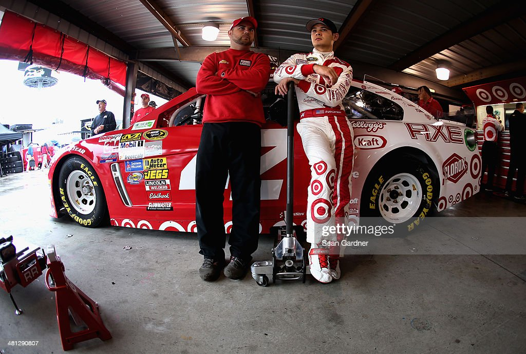 <a gi-track='captionPersonalityLinkClicked' href=/galleries/search?phrase=Kyle+Larson+-+Race+Car+Driver&family=editorial&specificpeople=2115989 ng-click='$event.stopPropagation()'>Kyle Larson</a>, driver of the #42 Target Chevrolet, right, talks with a crew member in the garage area during practice for the NASCAR Sprint Cup Series STP 500 at Martinsville Speedway on March 29, 2014 in Martinsville, Virginia.