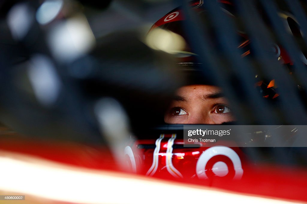 Kyle Larson, driver of the #42 Target Chevrolet, sits in his car in the garage area during practice for the NASCAR Sprint Cup Series Quicken Loans 400 at Michigan International Speedway on June 14, 2014 in Brooklyn, Michigan.
