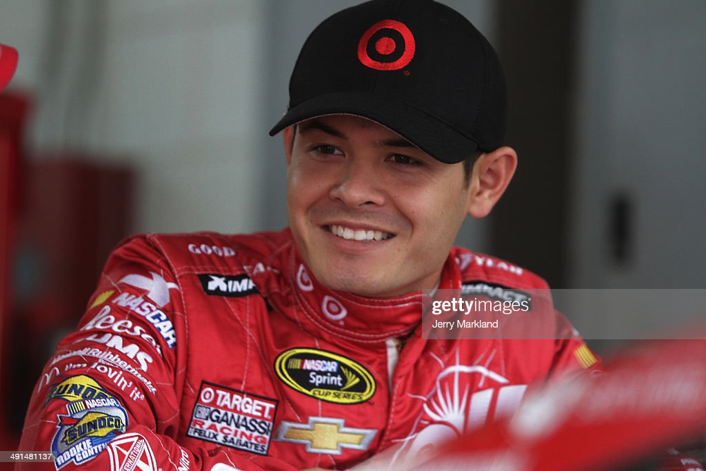 <a gi-track='captionPersonalityLinkClicked' href=/galleries/search?phrase=Kyle+Larson+-+Race+Car+Driver&family=editorial&specificpeople=2115989 ng-click='$event.stopPropagation()'>Kyle Larson</a>, driver of the #42 Target Chevrolet, stands in the garage area during practice for the NASCAR Sprint Cup Series Sprint Showdown at Charlotte Motor Speedway on May 16, 2014 in Charlotte, North Carolina.