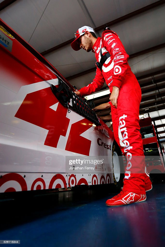 Kyle Larson, driver of the #42 Target Chevrolet, stands in the garage area during practice for the NASCAR Sprint Cup Series GEICO 500 at Talladega Superspeedway on April 29, 2016 in Talladega, Alabama.