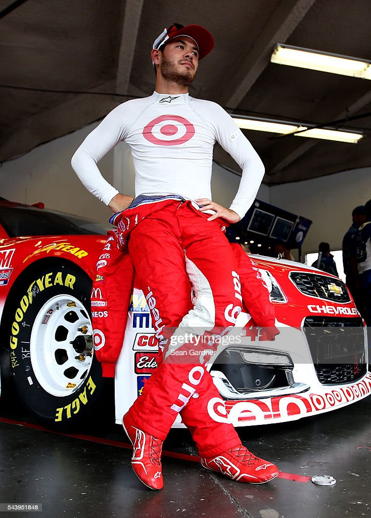<a gi-track='captionPersonalityLinkClicked' href=/galleries/search?phrase=Kyle+Larson+-+Race+Car+Driver&family=editorial&specificpeople=2115989 ng-click='$event.stopPropagation()'>Kyle Larson</a>, driver of the #42 Target Chevrolet, stands in the garage area during practice for the NASCAR Sprint Cup Series Coke Zero 400 at Daytona International Speedway on June 30, 2016 in Daytona Beach, Florida.