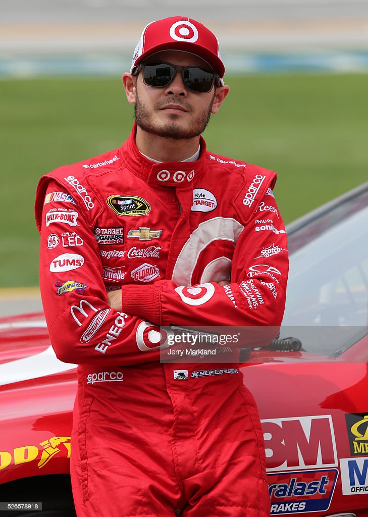 Kyle Larson, driver of the #42 Target Chevrolet, stands on the grid during qualifying for the NASCAR Sprint Cup Series GEICO 500 at Talladega Superspeedway on April 30, 2016 in Talladega, Alabama.