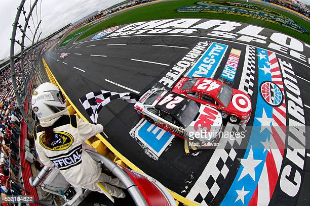 Kyle Larson driver of the Target Chevrolet takes the checkered flag against Chase Elliott driver of the 3M Chevrolet to win the third segment of the...