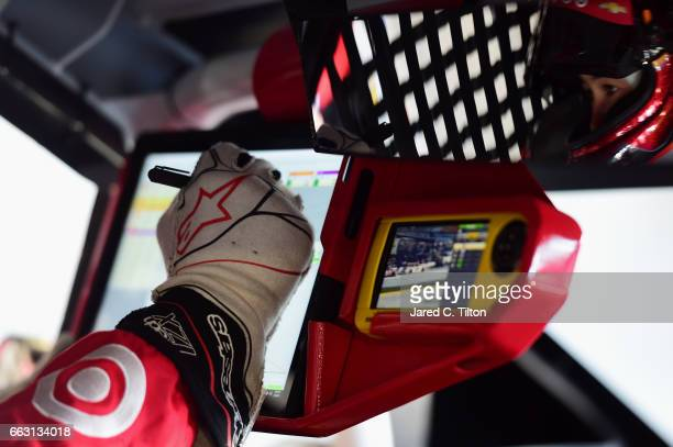 Kyle Larson driver of the Target Chevrolet uses a stylus on a video screen during practice for the Monster Energy NASCAR Cup Series STP 500 at...