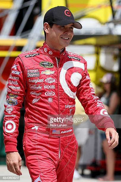 Kyle Larson driver of the Target Chevrolet walks through the garage area during practice for the NASCAR Sprint Cup Series OralB USA 500 at Atlanta...