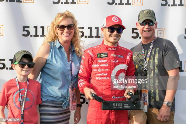 Kyle Larson poses for a photo with fans holding his 511 Tactical Battery Ram presented to the Pole Position Winner during Qualifying for the Auto...