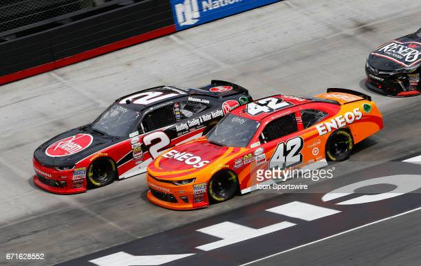Kyle Larson pressures Austin Dillon during the Fitzgerald Glider Kits 300 NASCAR Xfinity Series race on April 22 2017 at Bristol Motor Speedway in...