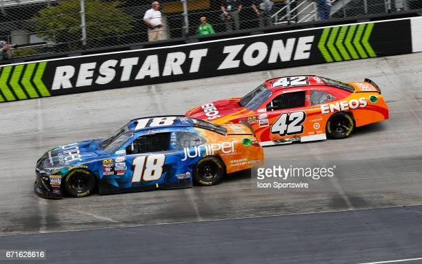 Kyle Larson pressures Daniel Suarez Juniper Toyota Camry during the Fitzgerald Glider Kits 300 NASCAR Xfinity Series race on April 22 2017 at Bristol...