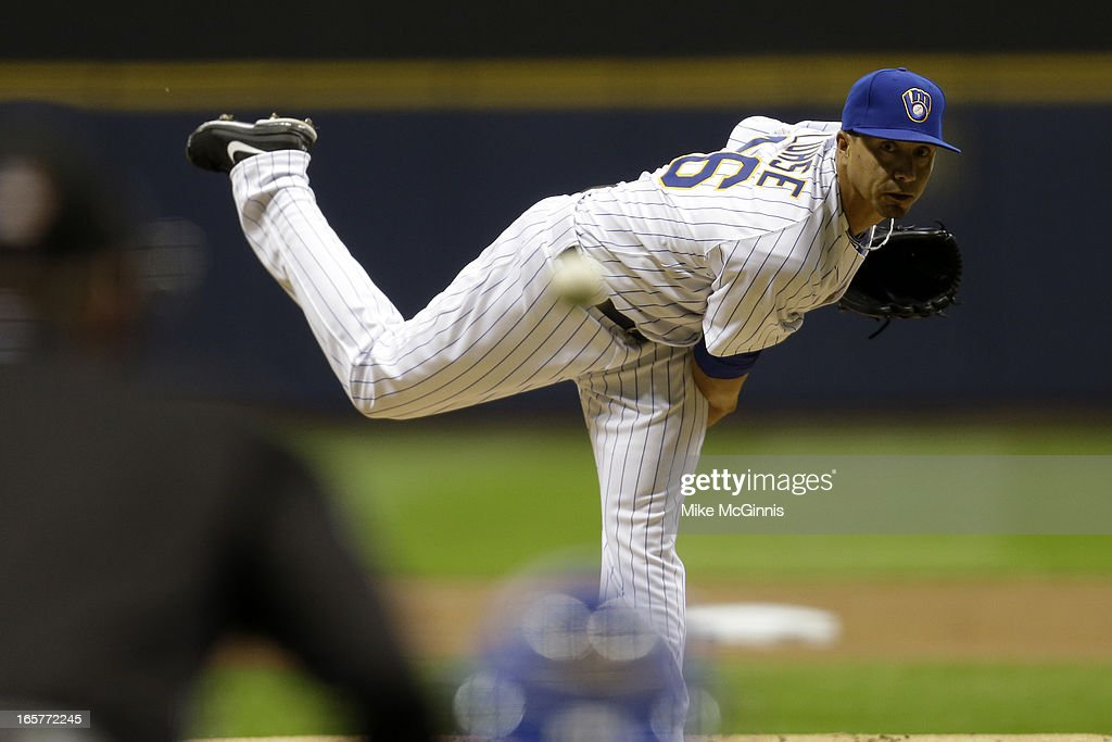 <a gi-track='captionPersonalityLinkClicked' href=/galleries/search?phrase=Kyle+Lohse&family=editorial&specificpeople=218037 ng-click='$event.stopPropagation()'>Kyle Lohse</a> #26 of the Milwaukee Brewers pitches in the top of the first inning against the Arizona Diamondbacks during the game at Miller Park on April 5, 2013 in Milwaukee, Wisconsin.
