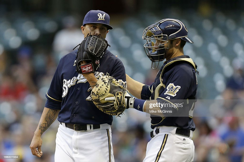 <a gi-track='captionPersonalityLinkClicked' href=/galleries/search?phrase=Kyle+Lohse&family=editorial&specificpeople=218037 ng-click='$event.stopPropagation()'>Kyle Lohse</a> #26 of the Milwaukee Brewers talks to <a gi-track='captionPersonalityLinkClicked' href=/galleries/search?phrase=Jonathan+Lucroy&family=editorial&specificpeople=5732413 ng-click='$event.stopPropagation()'>Jonathan Lucroy</a> #20 in the top of the first inning against the Texas Rangers during the game at Miller Park on May 08, 2013 in Milwaukee, Wisconsin.